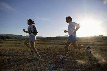 Man and woman running at sunset,  California,  USA