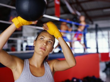 Close-up of a lady boxer hitting a speed bag