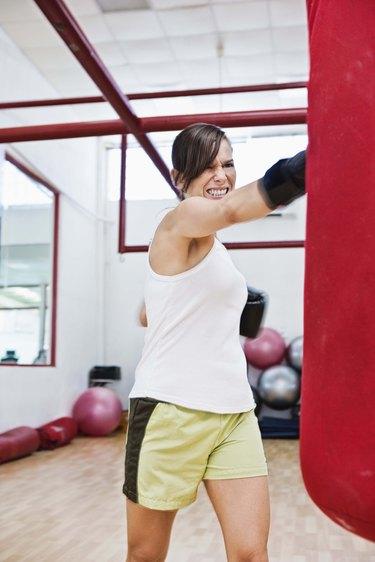 Woman boxing a punching bag