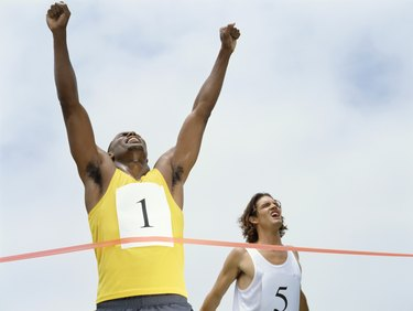 low angle view of male athlete crossing the finish line