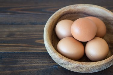 Eggs in wood bowl background
