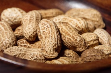 Peanuts in wooden dish closeup macro