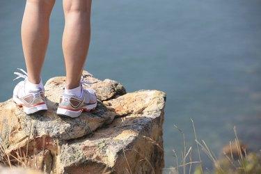 hiking feet seaside rock