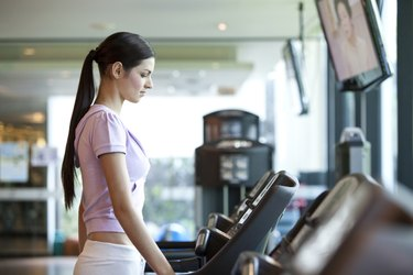 A young woman walking on the treadmill