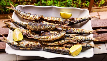 Barbequed Sardines on white plate.