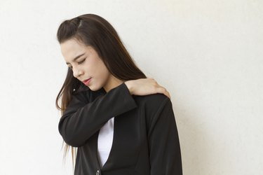 shoulder pain or stiffness of female business executive