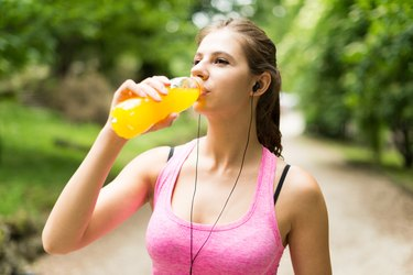 Woman drinking after sport