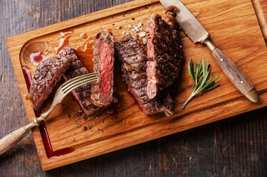 Sliced medium rare grilled steak Ribeye with rosemary