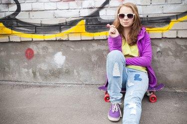 Blond teenage girl with lollipop, urban portrait
