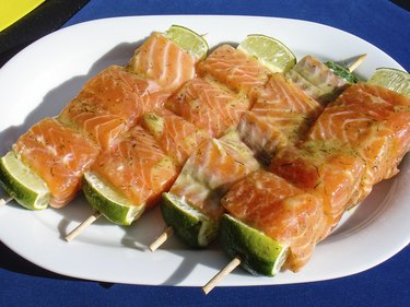 salmon skewer with lemon ready for BBQ