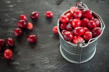 Cranberries in small zinc bucket