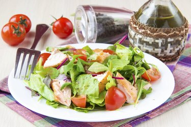 Delicious fresh salad with salmon, lettuce, cherry tomatoes