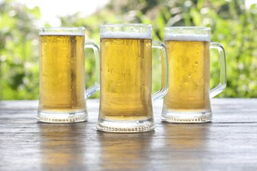 3 glasses of non alcoholic beer on wooden table