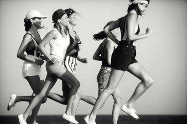 Women jogging, side view
