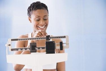 African American woman weighing self