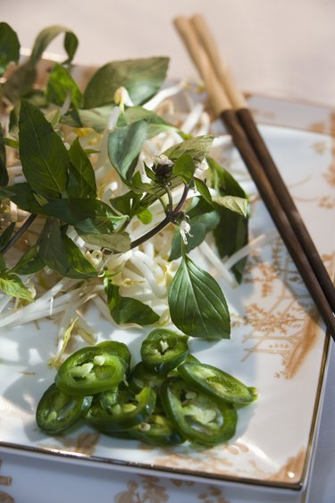 Jalapeno slices with fresh greens and bean sprouts
