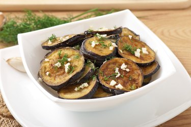 Platter of grilled eggplant with garlic and dill