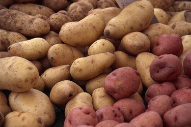 A stack of russet and red potatoes