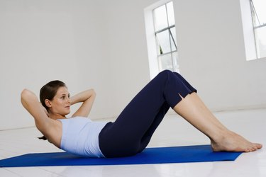 Woman strengthening core muscles