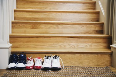 Sneakers lined up at bottom of stairs