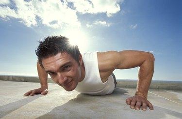 Man doing push-up outdoors