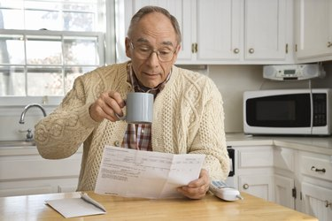 Man with coffee and mail