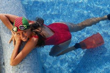Woman in pool wearing swim cap