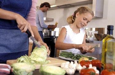 Girl preparing vegetables