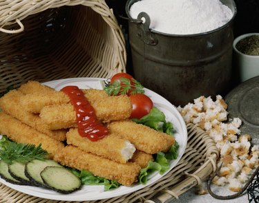 Fried fish sticks with sauce in a plate