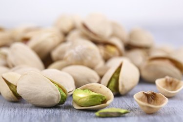 Pistachio nuts on table close up