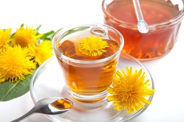 dandelion herbal tea on white background, with honey and leaf