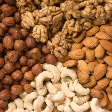 Different nuts (almonds, cashews, walnuts and filbers) close up
