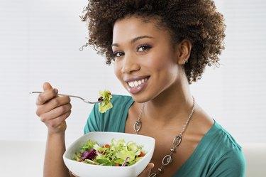 African American Woman Eating Salad