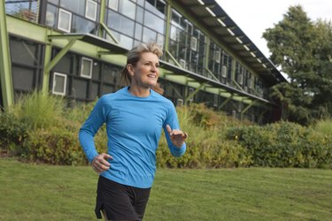 Fit Mature Woman Running Near Office Building