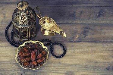 Dates, arabian lantern and rosary. Ramadan decoration
