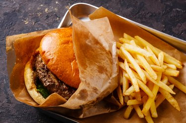 Burger and French fries in aluminum tray