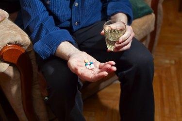 Old Man Taking Medicine