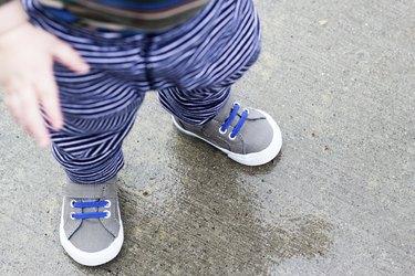 Little Boy Walking in the Rain