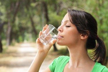 woman drinking water glass