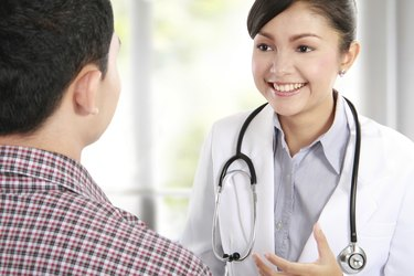 female doctor listening to her patient