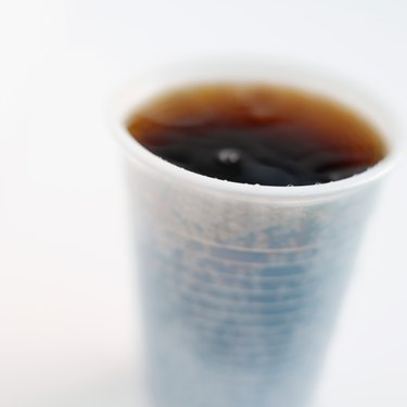 Close-up of a plastic cup of cola