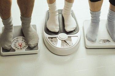 People standing on bathroom scales