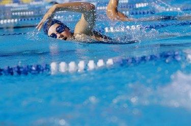 Young woman racing in swimming pool