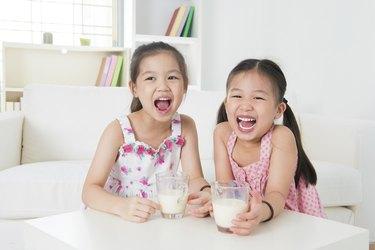 Children drinking milk.