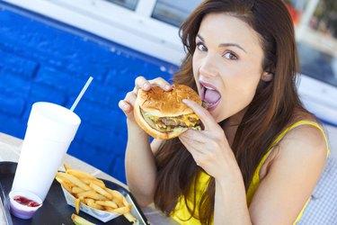 Woman Eating a Delicious Hamburger
