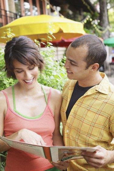Couple holding restaurant menu