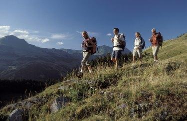 Men and women hiking on mountainside