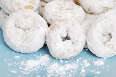 small icing sugar covered donuts
