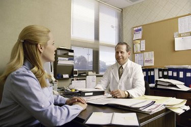 Female patient consulting a male doctor