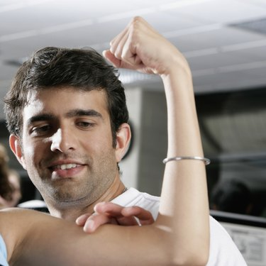 Close-up of a young man touching a woman's bicep